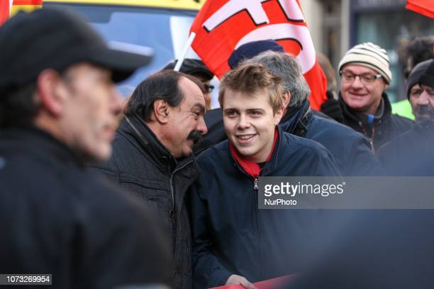 CGT Union general secretary Philippe Martinez speaks with the President of High school union Louis Boyard during a demonstration to call for politcal...
