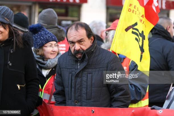 CGT Union general secretary Philippe Martinez takes part in a demonstration to call for politcal measures against high living costs on December 14...