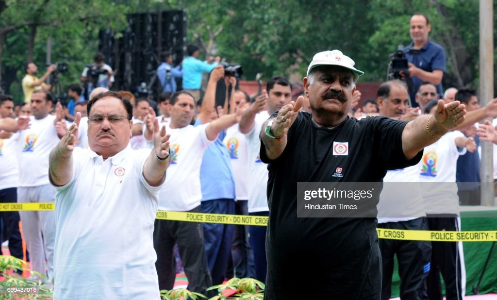 Union Health Minister JP Nadda Punjab Governor VP Singh Badnore during the 3rd International Day of Yoga at Plaza Sector 17 on June 21 2017 in...