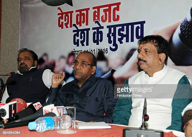 Union Heavy Industries Minister Anant Geete flanked by the Bhopal Mayor Alok Sharma and Madhya Pradesh Rural Industries Minister Gopal Bhargava at a...