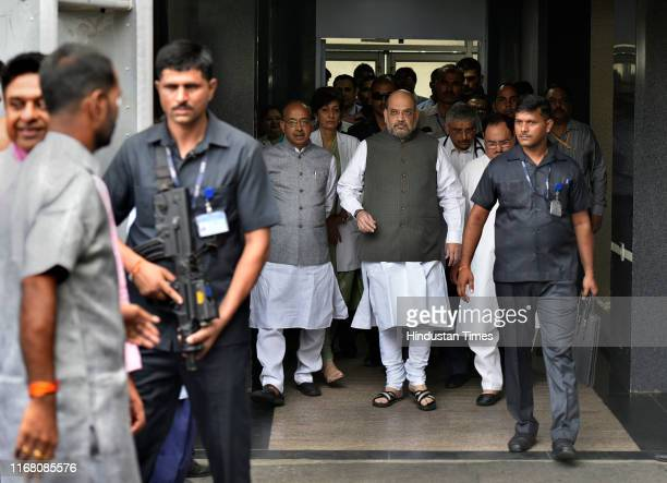 Union Home Minister Amit Shah leaves after a meeting with cleaning staff of AIIMS during the launch of partys 'Seva Saptah', at All India Institute...