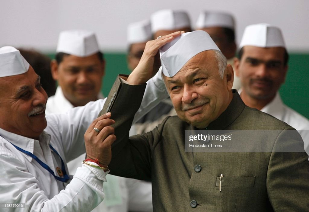Union Home Minister and senior Congress leader Sushil kumar Shinde wearing a Gandhi cap during the Indian National Congress party's 127th foundation day function at AICC headquarters on December 28, 2012 in New Delhi, India.