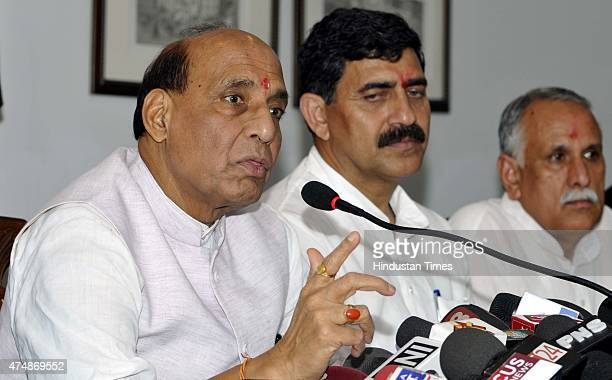 Union Home Minister Rajnath Singh along with MP Jugal Kishore Sharma and MP Shamsher Singh Manhas addressing a press conference on May 27 2015 in...