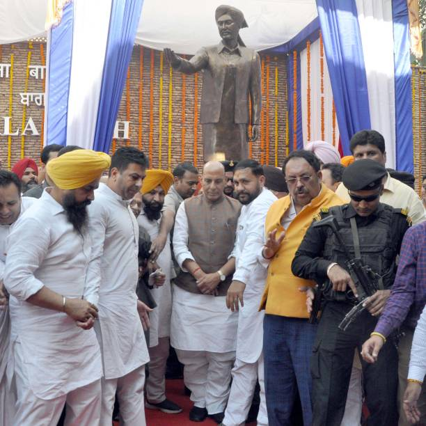 Union Home Minister Rajnath Singh and others standing in front after unveiling Statue of Saheed Udham Singh at Jallianwala Bagh on March 13 2018 in...