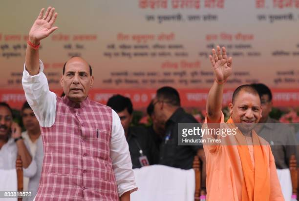 Union Home Minister Rajnath Singh and UP Chief Minister Yogi Adityanath wave their hands at loan waiver certificate distribution event on August 17...