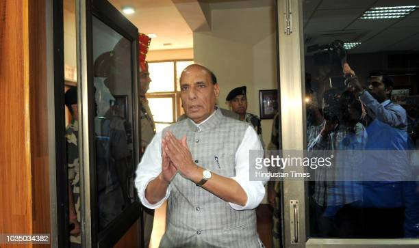 Union Home Minister Rajnath Singh speaks as Union minister Jitendra Singh and DG BSF K K Sharma look on during a press conference after the...