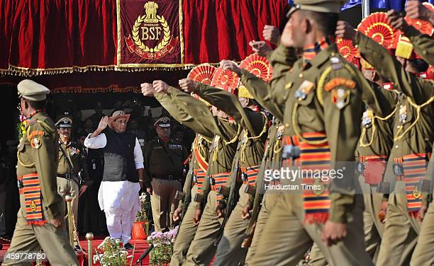 Union Home Minister Rajnath Singh takes salute of Parade on 49th Raising day of BSF at Chawala Camp on December 1 2014 in New Delhi India The force...