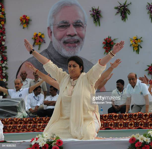 Union HRD minister Smriti Irani performs yoga at Lal Parade Ground on Tuesday to mark the International Yoga Day on June 21 2016 in Bhopal India Mass...