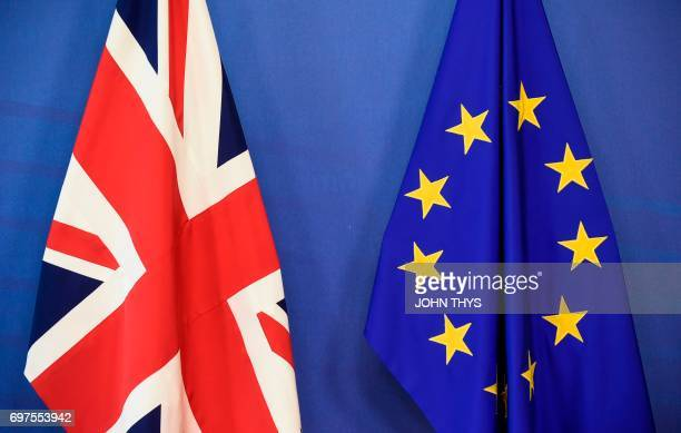 A Union Jack and a flag of the European Union are seen at the European Commission in Brussels on June 19 as Britain starts formal talks to leave the...