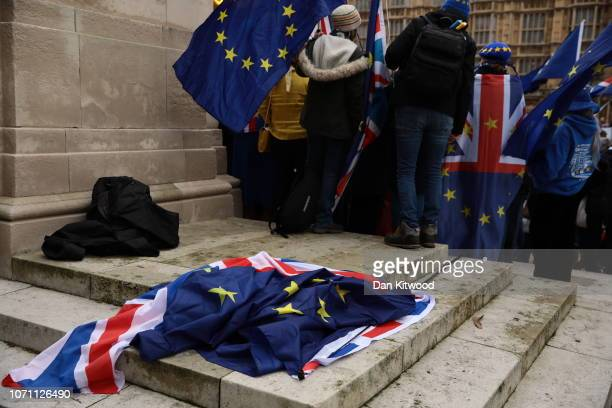 Union Jack and European Union flags lay discarded on the floor outside the Houses of Parliament in Westminster on December 10 2018 in London England...