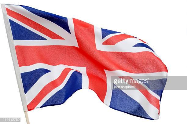 union jack british flag blowing in wind against white - britse vlag stockfoto's en -beelden