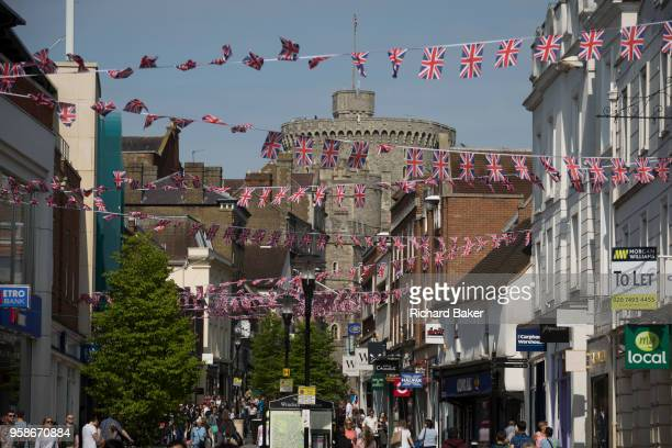 Union jack bunting hangs between shops as the royal town of Windsor gets ready for the royal wedding between Prince Harry and his American fiance...
