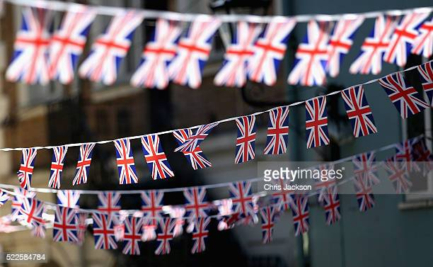 Union Jack bunting hangs from buildings ahead of the Queen's 90th Birthday outside Windsor Castle ahead of the Monarch's 90th Birthday tommorow on...