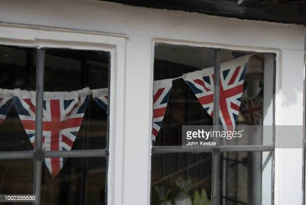 Union Jack bunting is seen hanging in an old leaded shop window in the Cotswolds on July 10 2018 in Broadway England
