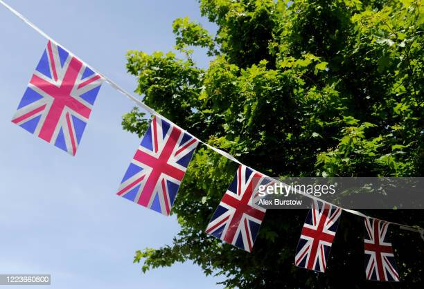 Union Jack bunting is seen hanging outside a house to commemorate the 75th Anniversary of Victory in Europe Day on May 08 2020 in Church Crookham...