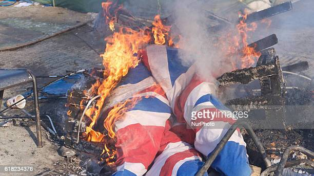 Union Jack burn during eviction of the Calais 'Jungle' camp in Calais northern France on October 25 2016 French authorities began on October 25 2016...
