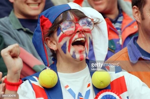 Union Jack Face Painted fan of Tim Henman support the English tennis player during his Fourth Round Match of the Mens Singles with Holland's Richard...