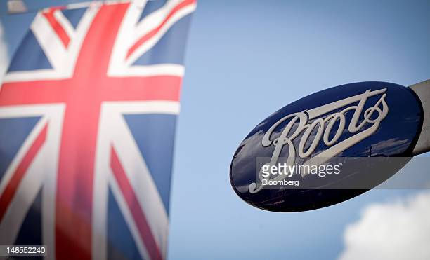 A Union Jack flack flies in front of a sign outside a Boots store operated by Alliance Boots in London UK on Tuesday June 19 2012 Walgreen Co the...