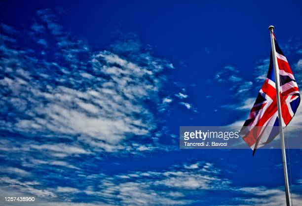 union jack flag against cloudy sky - bavosi stock pictures, royalty-free photos & images