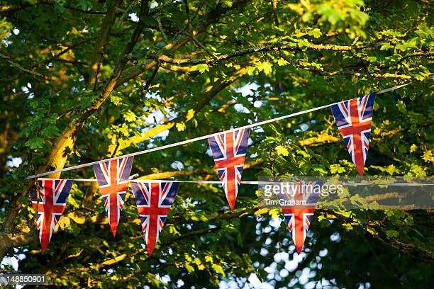 Union Jack flag bunting at street party to celebrate the Queen's Diamond Jubilee in Swinbrook in the Cotswolds UK