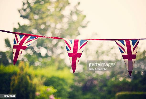 union jack flag bunting - bunting stock pictures, royalty-free photos & images