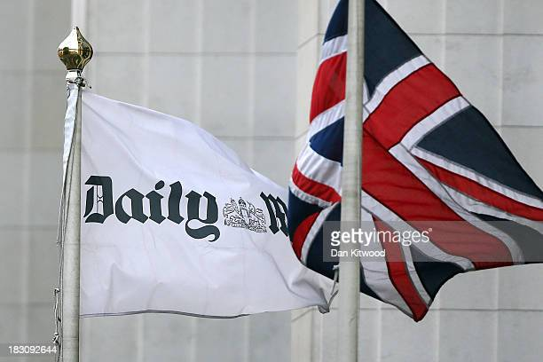 Union Jack flag flies beside a flag advertising the Daily Mail outside Northcliffe House where the offices of British newspapers the Daily Mail and...