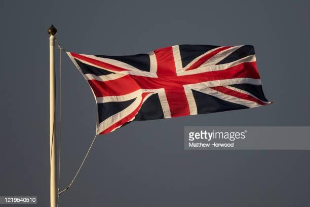 Union Jack flag flying against a dark sky on March 08, 2020 in Cardiff, United Kingdom.