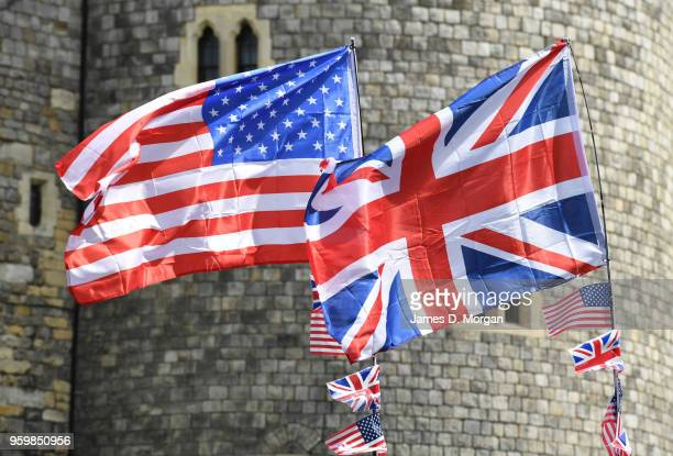 Union Jack flag of the United Kingdom and the Stars and Stripes of the United States fly against the castle on May 18 2018 in Windsor England The...