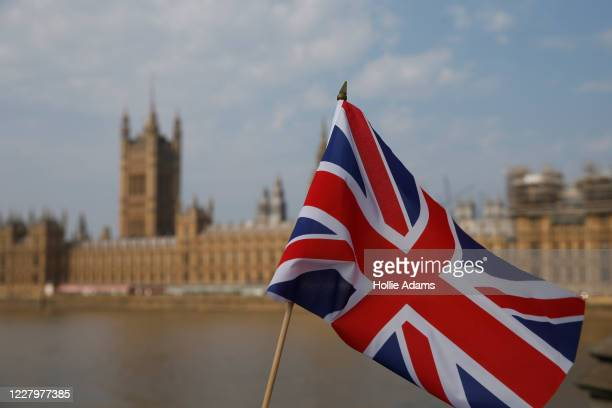 Union Jack flag outside the Houses of Parliament on August 9, 2020 in London, United Kingdom. Southern England saw several days of high temperatures,...