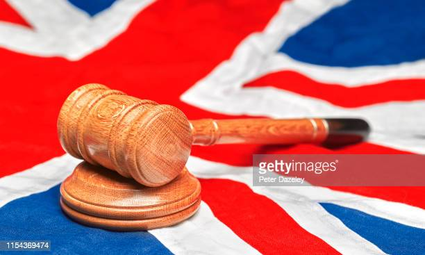 union jack flag with gavel - justice concept stock pictures, royalty-free photos & images
