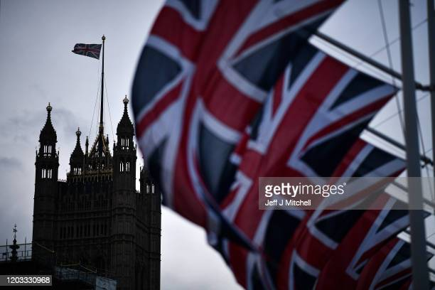 Union Jack flags hang in parliament square on February 1, 2020 in London, England. Last night Brexit supporters celebrated at 11.00pm as the UK and...