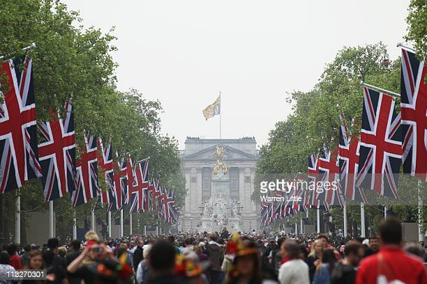 Union Jack flags line the area as Prince William and Princess Catherine greet wellwishers from the balcony at Buckingham Palace on April 29 2011 in...