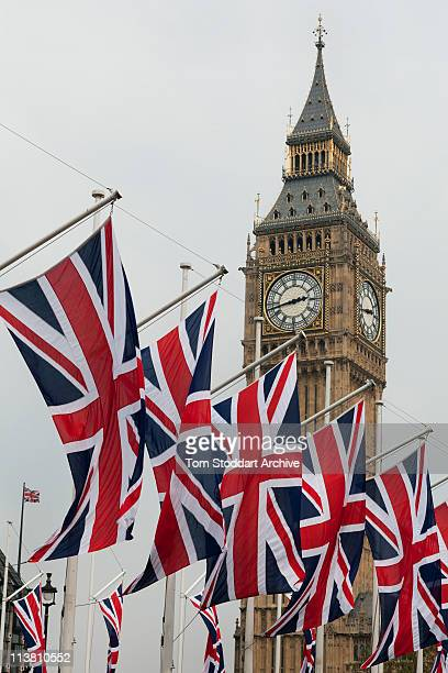Union Jack flags proudly fly near Big Ben at the British Parliament during the wedding of Prince William and Kate Middleton, London, 29th April 2011.