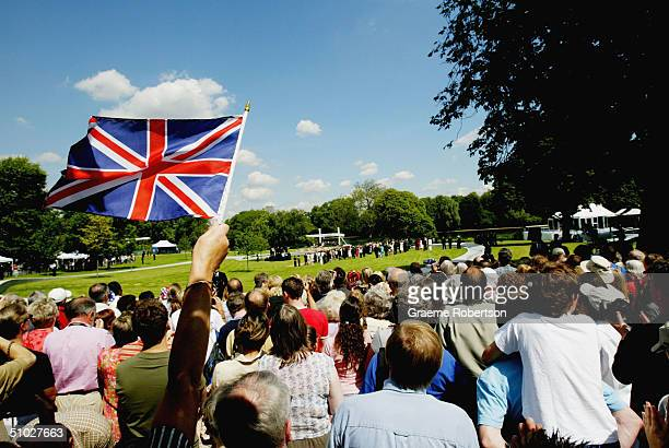 Union Jack flies as well wishers gather at the opening of the Diana Memorial Fountain in memory of the late Princess Diana at the south side of the...