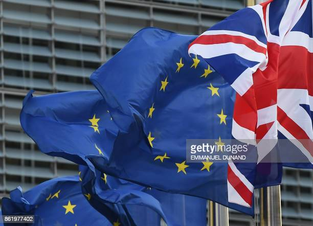 A Union Jack flies next to European Union flags in front of the European Commission building as British Prime Minister May is due to meet European...