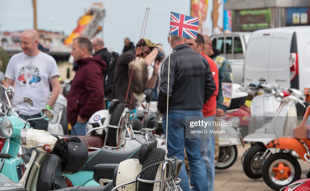 A union jack flies on a Lambretta moped on August 12, 2017 in Great Yarmouth, England. A cloudy overcast day greeted visitors to the Norfolk seaside town on one of the busiest weekends of the summer period. The town has been a seasiside resort since 1760 and today it has developed renewable energy sources with a wind farm of 30 generators within sight of the town in the North Sea. Thousands of British holidaymakers will visit the area over the summer period.