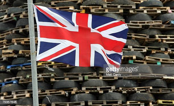 Union Jack flutters in the wind in front of a bonfire made from pallets and old tyres on the Loyalist Ballycraigy estate in Antrim on July 11 2007...