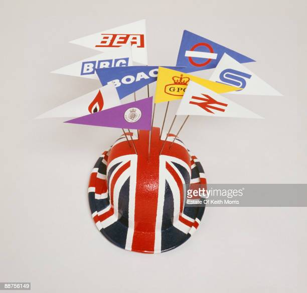 A Union Jack hat bristling with the logos of British companies and institutions including BEA BBC BOAC British Gas Ministry of Transport London...