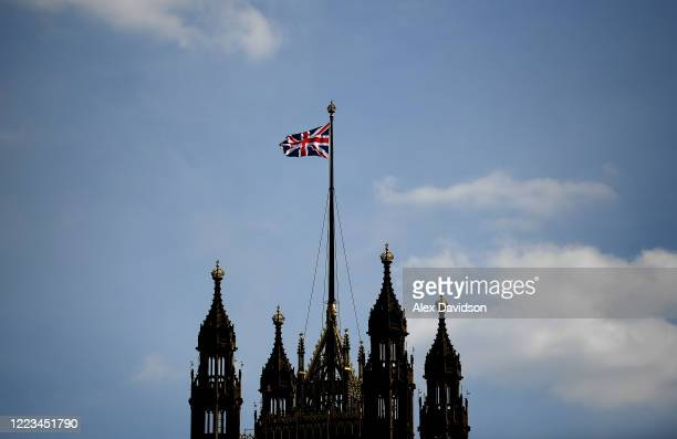 Union Jack is seen flying from the Houses of Parliament on May 07 2020 in London England United Kingdom The UK will commemorate the 75th Anniversary...