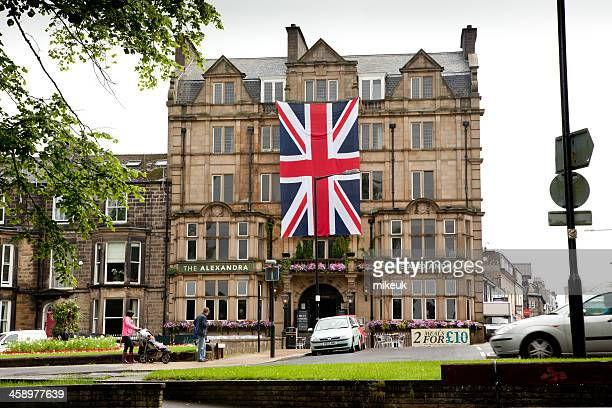 union jack on hotel in harrogate uk - north yorkshire stock pictures, royalty-free photos & images