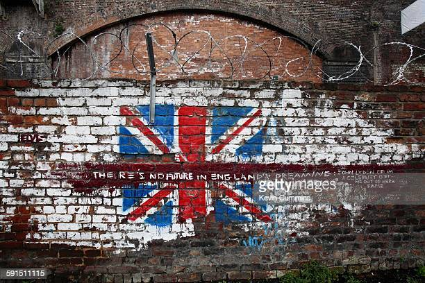 A union jack painted on a brick wall with the text 'There's no future in England's dreaming' a line from the 1977 Sex Pistols song 'God Save the...