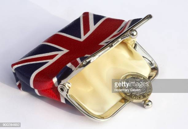 Union jack purse with just one one pound coin in it.