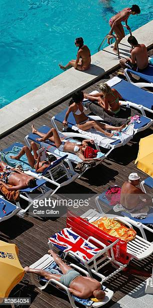 Union Jack towel is left on a sun lounger as a British holiday maker enjoys the pool at the Oasis Park Hotel and Apartments on August 15 2008 in...