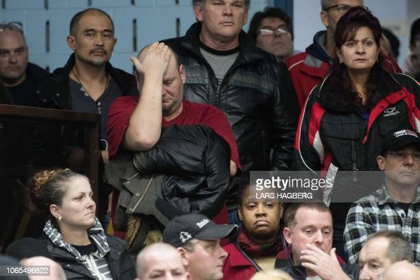 A union member reacts as union leaders speak at Local 222 in Oshawa Ontario on November 26 2018 In a massive restructuring US auto giant General...
