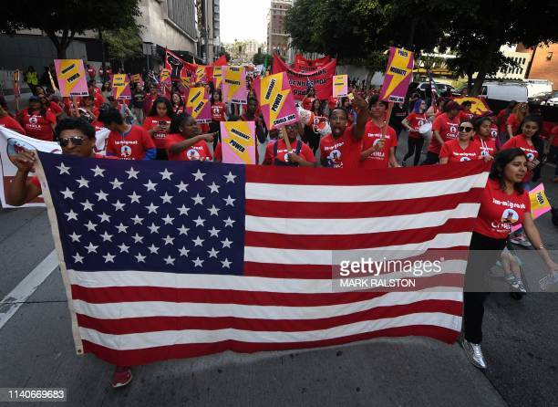 Union members, activists and their supporters march through the city during their annual May Day procession in support of workers' rights and...