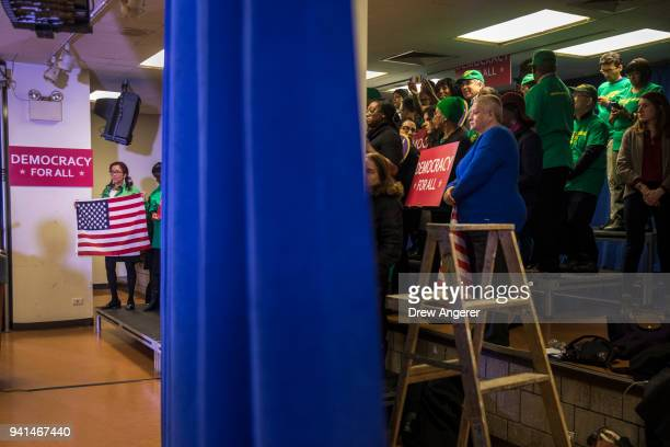 Union members and supporters wait for the start of a press conference with New York Attorney General Eric Schneiderman to announce a multistate...