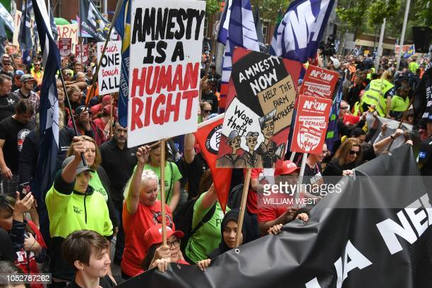 Union members chant during a rally through the streets of Melbourne on October 23 2018 Protests were held in capital cities across Australia as part...