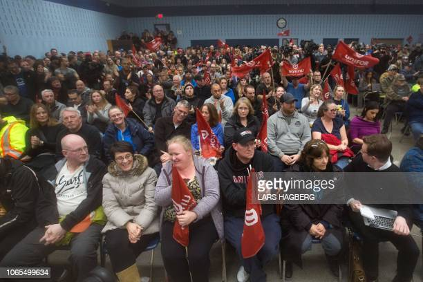Union members cheer after union leaders said they use any tools they had to fight General Motors from closing their plant at Local 222 in Oshawa...