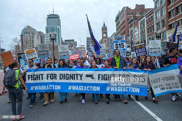 Union members from Service Employees International Union SEIU march through the streets of Boston as part of the 'Fight for 15' protests on April...