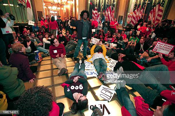 Union members hold a sitin in the rotunda of the Michigan State Capitol to protest a vote on RighttoWork legislation December 11 2012 in Lansing...